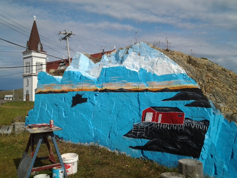 The painted rock in Fogo was getting a facelift.
