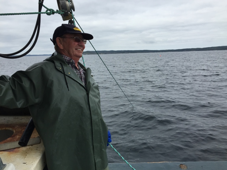 Aubrey Payne on the water testing cod pots.