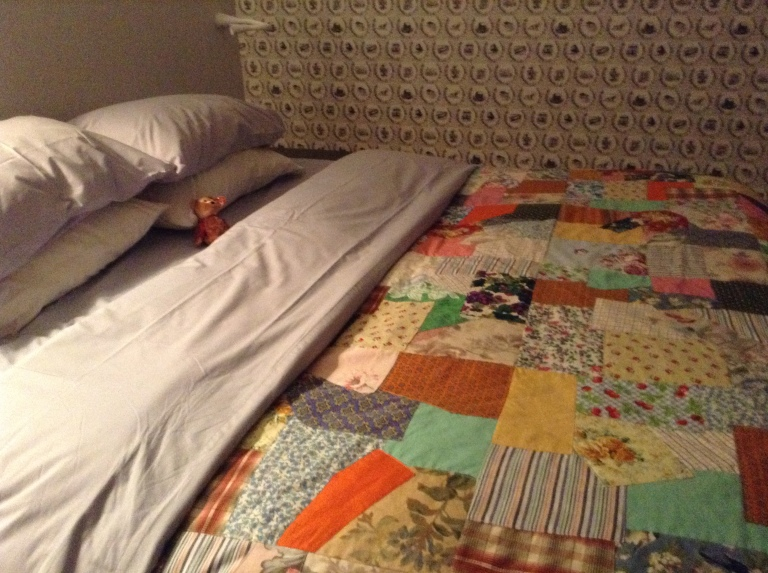 Spread out in the middle of the bed under a Fogo Island Quilt.